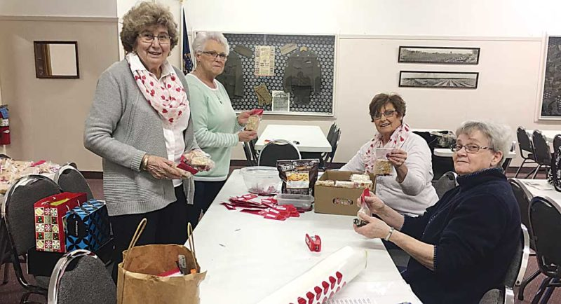 """Submitted Photo Veterans of Foreign Wars Auxiliary members assemble Valentine's Day treat bags for """"Salute to Hospital Veterans.""""  They distributed the treat bags to more than 150 veterans at seven nursing homes and assisted living facilities in the city of Minot. Shown are, from the left clockwise, Adeline Guy, Sharol Paulson, Peggy Headrick and Diane Earhart."""