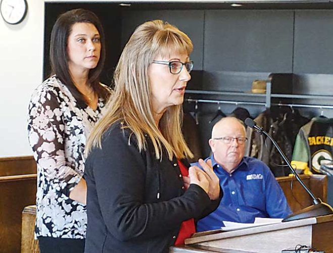 Jill Schramm/MDN Ward County human resources coordinator Colleen Houmann speaks to the commission as Genny Dienstmann and Chuck Horter with the North Dakota Association of Counties listen in the background.