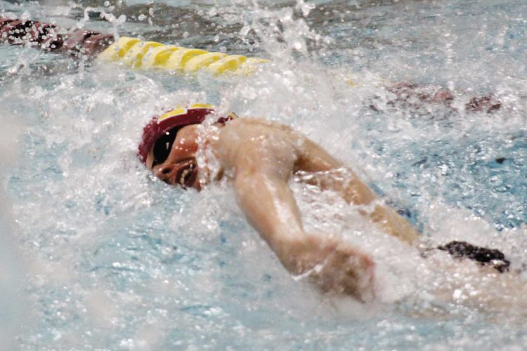 Ashton Gerard/MDN Zac Spaulding, a sophomore swimmer for Minot High, takes a breath during the 100-yard freestyle event during a high school boys swim meet Thursday against Williston at Magic City Campus.