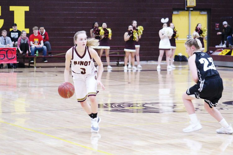 Ashton Gerard/MDN Minot High sophomore Paige Rosencrans (3), guarded by Mandan's Lizi Leingang (23), looks for the pass Thursday during a high school girls basketball game at Magic City Campus.