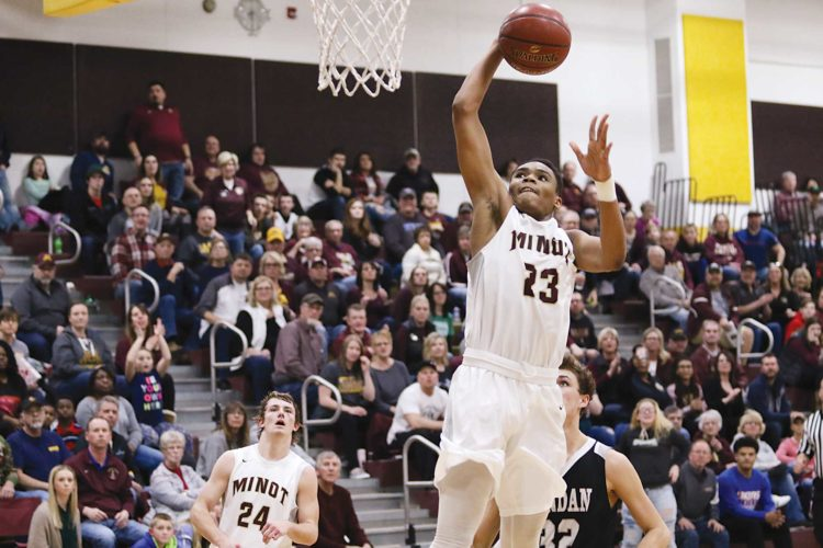 Pgoto courtesy of Sean Arbaut Minot High's Devin Mikell (23) puts up a shot during a boys high school basketball game Friday in Minot.