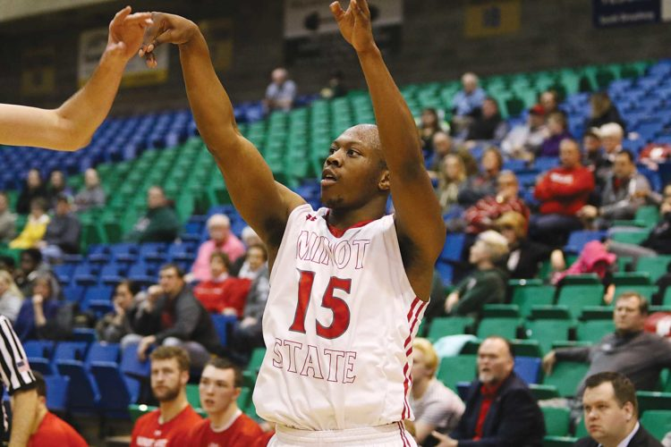 Sean Arbaut/Minot State athletics  Minot State's David Akibo (15) shoots a 3-pointer during a men's college basketball game Friday in Minot.