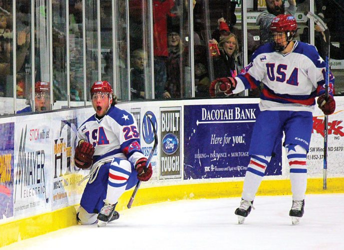 Alex Eisen/MDN Minotauros forward Fritz Belisle (left) celebrates after scoring the first goal Sunday afternoon against the Bismarck Bobcats at Maysa Arena in Minot.
