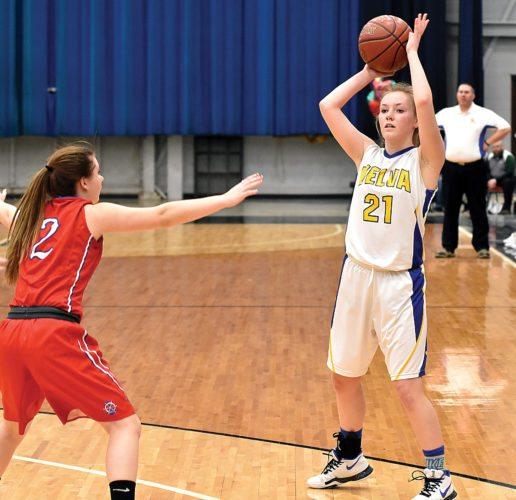 Garrick Hodge/MDN Velva's Sydney Larson (21) surveys the passing lanes during a Region 6 girls basketball game Monday in Minot.