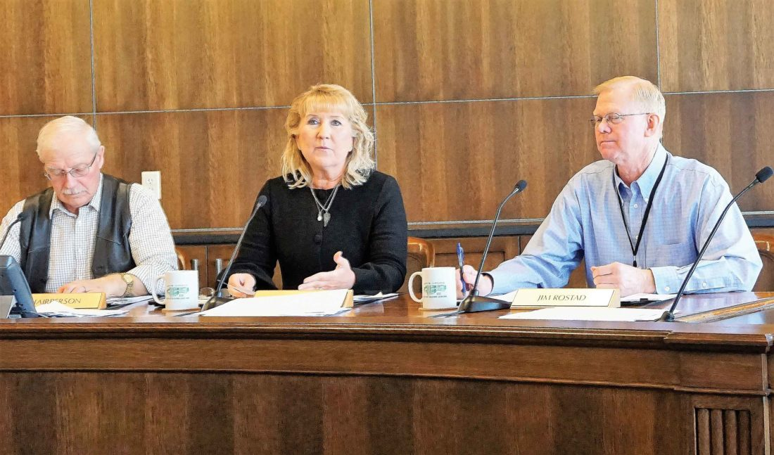 Jill Schramm/MDN Ward County Commissioner Shelly Weppler, center, comments during a discussion on the hiring of a human resources director as Commissioners Alan Walter, left, and Jim Rostad listen.