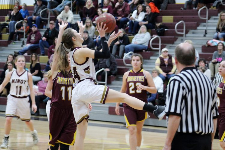 Ashton Gerard/MDN Minot High's Alli McCoy (14) goes for a layup Friday during a high school girls basketball against Turtle Mountain at Magic City Campus.