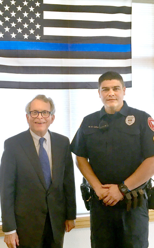 Morning Journal/Katie White Ohio Attorney General Mike DeWine is shown with Salem Patrolman Mike Garber, president of the Fraternal Order of Police Quaker Lodge No. 88. The lodge hosted the annual Peace Officer Memorial Service on Thursday and DeWine was the featured speaker.