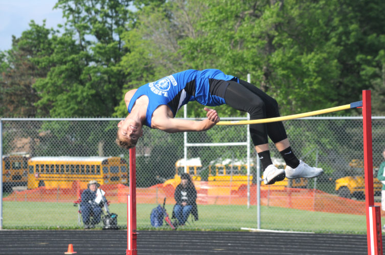 Lisbon junior Seth Stokes gets over 6-foot-8 1/4 on his second attempt, but kicks the bar off with his ankle at the Massillon Perry Division III regional meet Friday. Stokes won the regional title. (Photo by Ron Firth)