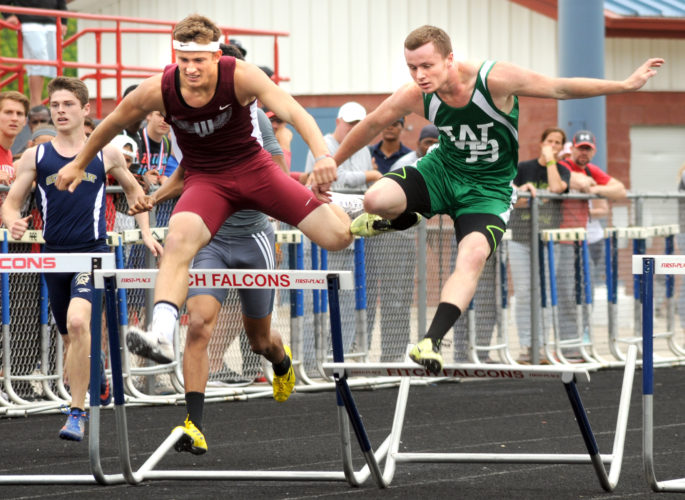West Branch's Rob Lozier (right) and Woodridge's Jacob Malley are on their way to a one-two finish in the 300-meter hurdles Saturday.