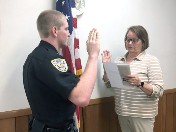 Morning Journal/Steve Rappach  Wellsville Mayor Nancy Murray swore in Chase Askounes as a  part-time police officer last week.