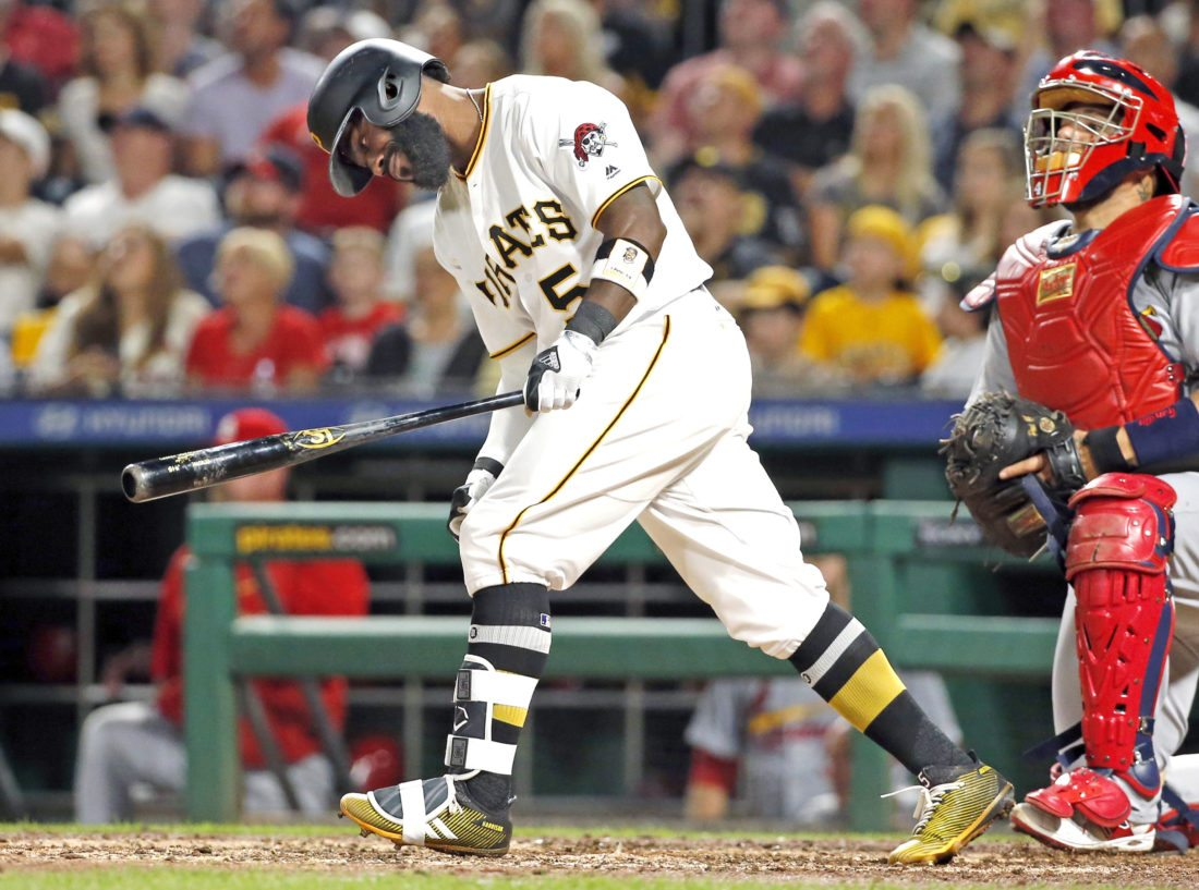 Pittsburgh Pirates' Josh Harrison pops out to left field with the bases loaded to end the seventh inning of the team's baseball game against the St. Louis Cardinals in Pittsburgh, Saturday, July 15, 2017. The Cardinals won 4-0. (AP Photo/Gene J. Puskar)