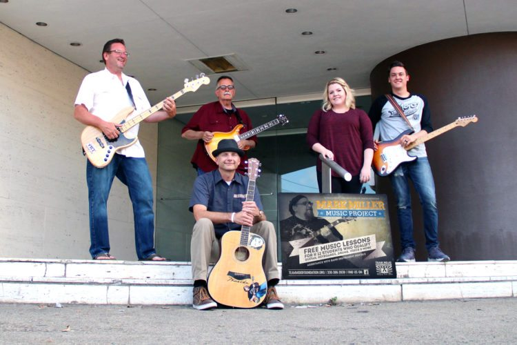 Submitted photo Local musicians (front) Bill Crawford, (back, from left) Mark Wilson, Arl Green, Sydney Smith and Jesse Smith will perform at 7 p.m. Friday at Scott Shepherd's Gallery at 515 in downtown East Liverpool. Doors open at 6:30 p.m. for this free event, however, donations will be accepted to help support Team Mojo Foundation's Mark Miller Music Project, which provides music instruction to underprivileged young people.