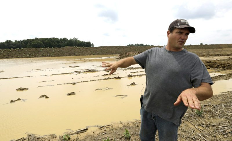 In this Wednesday, July 12, 2017 photo, Doug Phenicie, who farms about 1,800 acres in northern Ohio, talks about the damage caused to crops because of construction of a multi-state natural gas pipeline in New Washington, Ohio. The company that developed the Dakota Access oil pipeline is entangled in another fight, this time in Ohio where work on its multi-state natural gas pipeline has wrecked wetlands, flooded farm fields and flattened a 170-year-old farmhouse. (AP Photo/Tony Dejak)