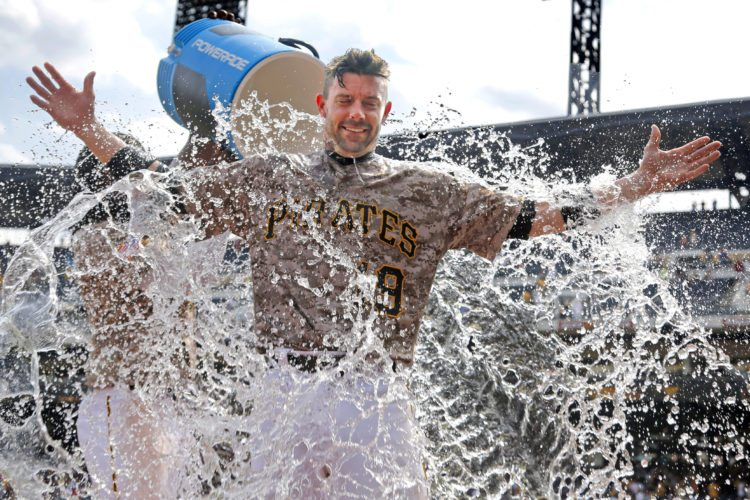 Pittsburgh Pirates' Chris Stewart gets doused by Josh Bell as he waits to be interviewed after a 4-2 Pirates win over the Milwaukee Brewers in a baseball game in Pittsburgh, Thursday, July 20, 2017. (AP Photo/Gene J. Puskar)