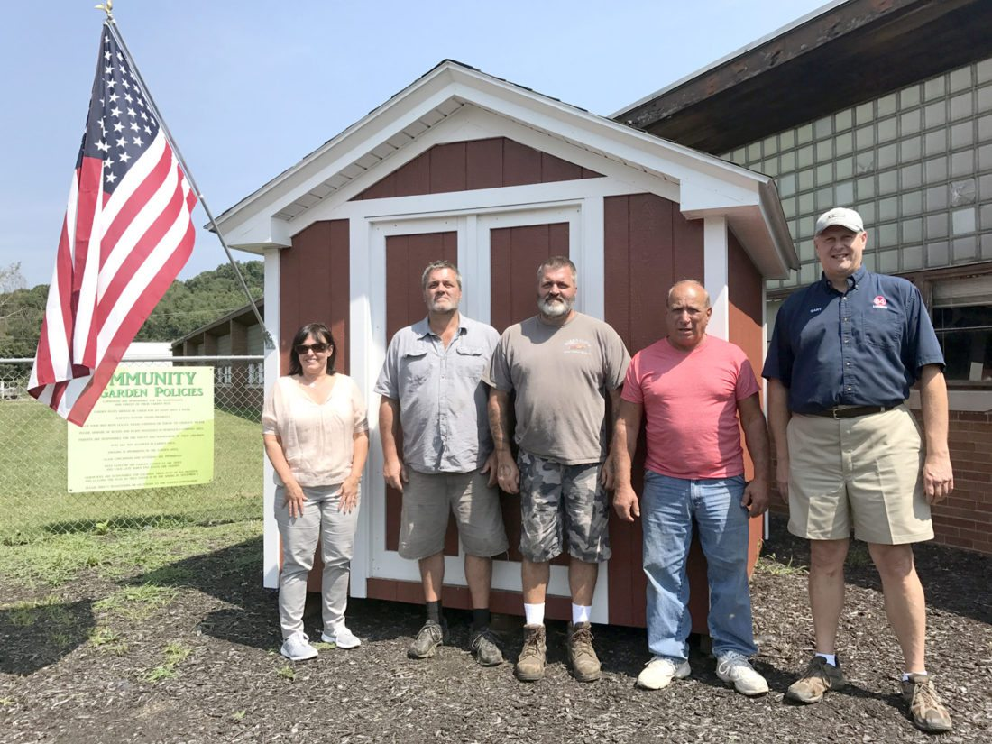 Morning Journnal/Jo Ann Bobby-Gilbert Checking out new additions to the East Liverpool Community Gardens, including this shed, are (from left) health Commissioner Carol Cowan, Gregg Stowers, Councilman Craig Stowers, Councilman Ray Perorazio and 84 Lumber manager Gary Lovell.