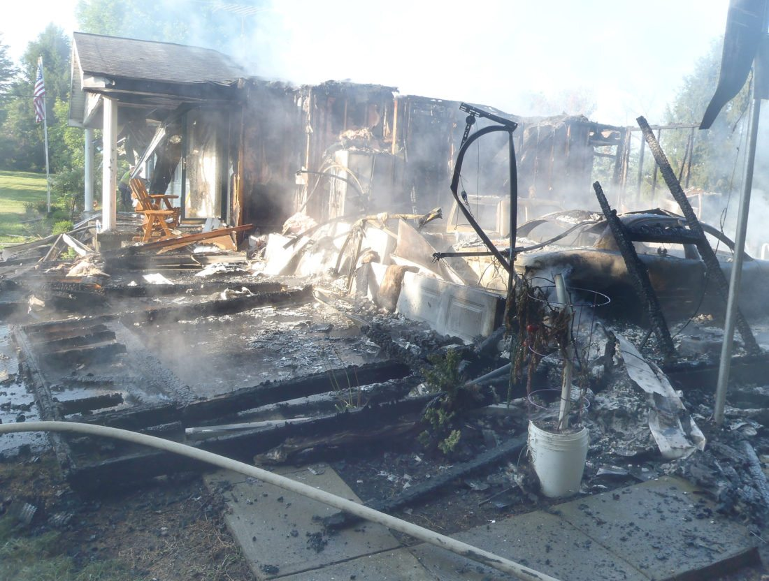Morning Journal/Tom Giambroni Nothing much remains of the garage at the Sias residence in Elkrun Township, which was destroyed by fire Wednesday morning. The fire of undetermined origin spread from the garage to the attached house, which also sustained heavy damage.