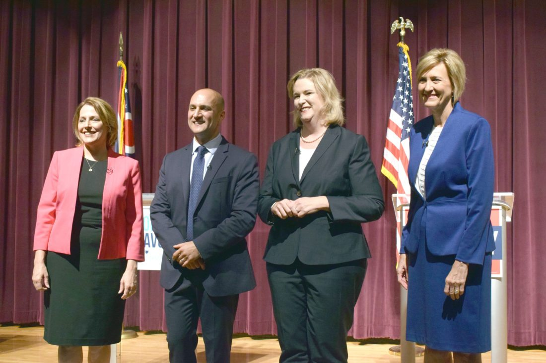 Special to the Journal/Scott McCloskey Ohio Democratic gubernatorial candidates posing for a photo at center stage after their first debate Tuesday at Martins Ferry High School, from left, are former state Rep. Connie Pillich; Ohio Sen. Joe Schiavoni, D-Boardman; Dayton Mayor Nan Whaley; and former U.S. Rep. Betty Sutton.