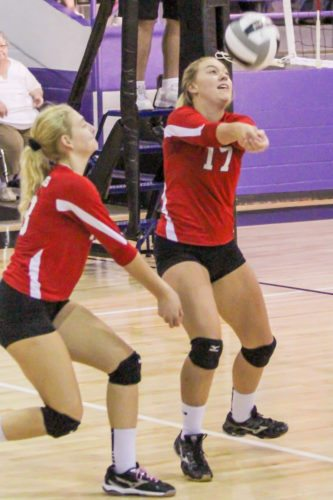 Columbiana's Alexis Cross and Morgan Highley go for the ball on Monday at Heartland Christian School. (Photo by Wayne Maris)