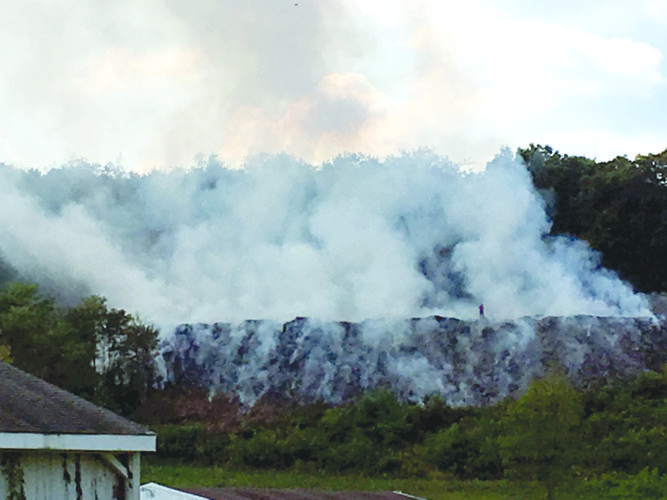 Morning Journal/Steve Rappach This view from Race Track Road in Newell shows a large billow of smoke as crews from a dozen area fire departments worked to extinguished a fire on a hillside on Trotter Drive.