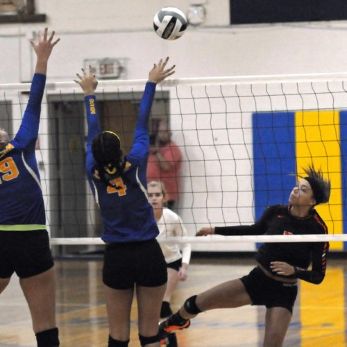 Morning Journal/Dan Santarelli Wellsville's Kinley Martin reacts after striking the ball on Thursday. Going up for the block are Southern's Riley Felton and Stella Karcher.