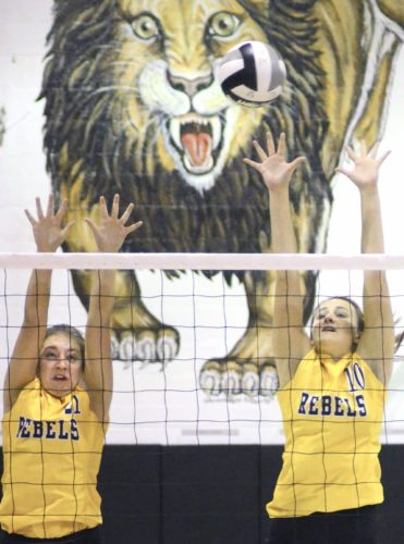 Morning Journal/Patti Schaeffer Crestview's Preslyn Wolfe (21) and Sidney Rambo (10) try to block an attack on Thursday at Heartland Christian.