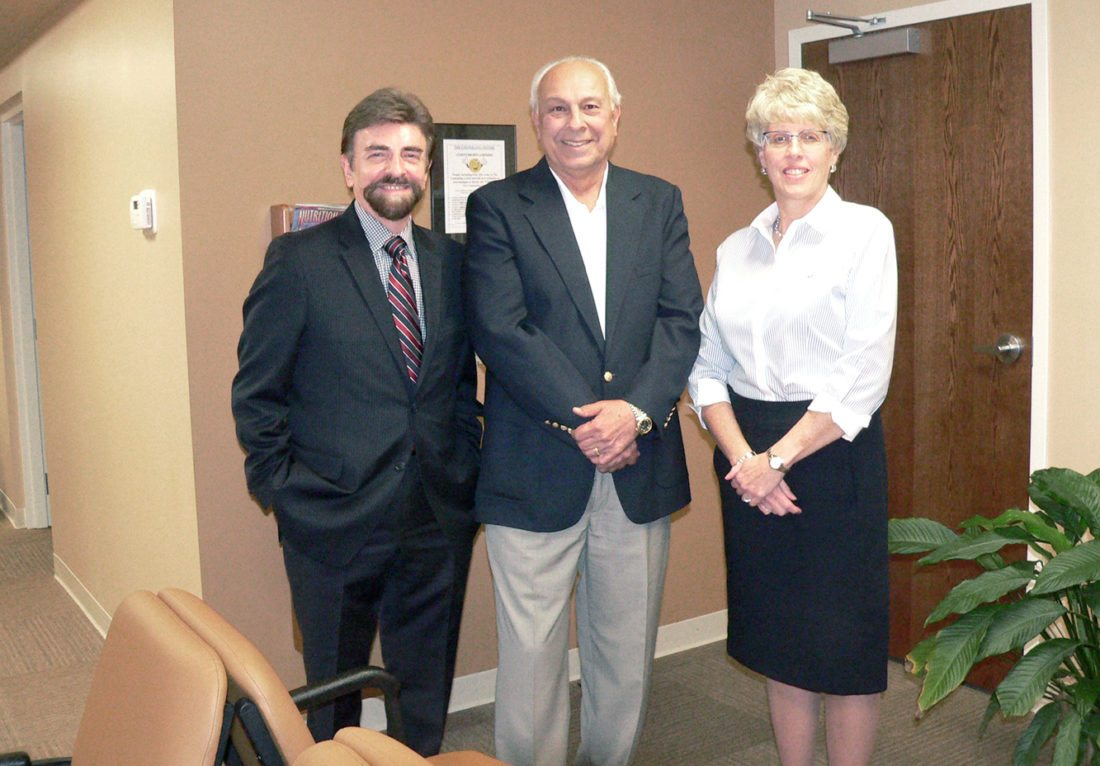 Morning Journal/Mary Ann Greier From left, Counseling Center Executive Director Roger Sikorszky gives a tour of the new Salem facility on Vine Avenue to Salem Community Foundation President John Tonti and SCF grants coordinator Melissa Costa.