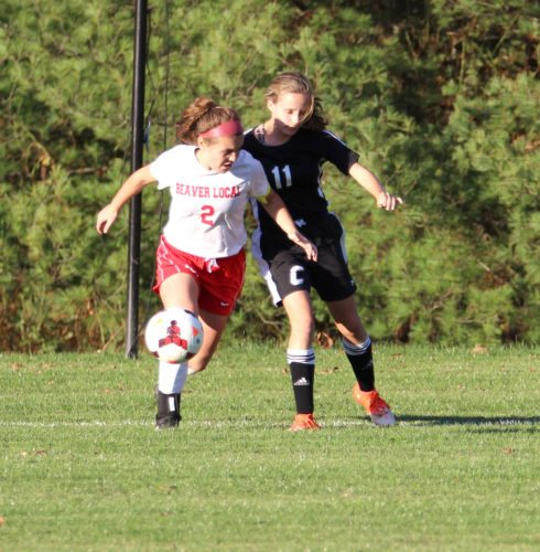 Submitted Photo/Jill Riccardo Beaver Local's Riley Britt challenges a Carrollton defender for the ball on Wednesday.