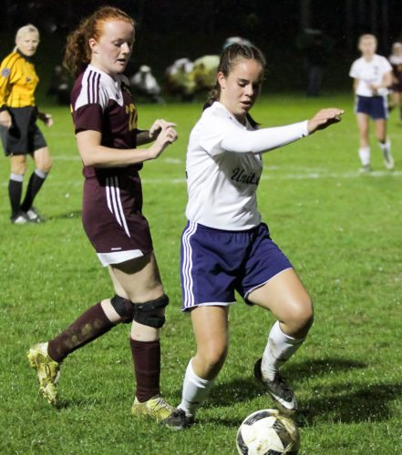 United's Morgan Briceland advances the ball against South Range's Allison Eicher in Division III district semifinal play Monday. Briceland scored the only goal in the Eagles' 1-0 win. (Morning Journal/Wayne Maris)