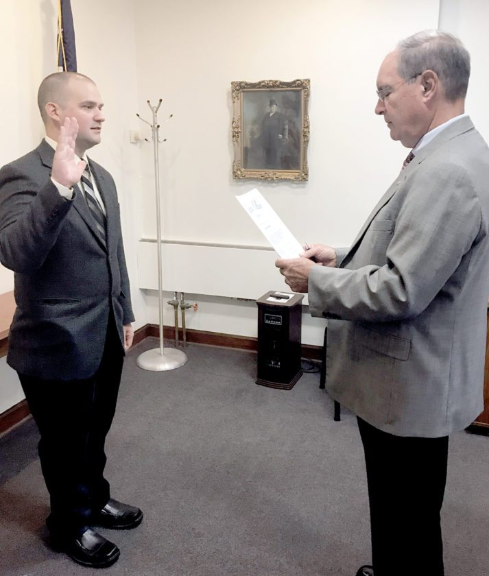 Submitted photo Salem's newest part-time police officer, David Miller, of Canfield, recites his oath of office administered by Salem Mayor John Berlin last week. Miller worked his first shift Friday. The Canfield High School graduate attended Kent State and completed his peace officer training at the KSU police academy in May 2015. He has worked as a part-time patrolman for both Goshen Township and Milton Township police departments.