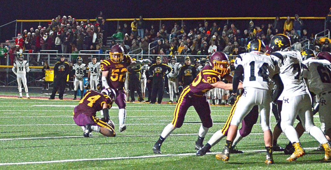 South Range's Levi Taylor kicks an extra point as Aniello Buzzacco holds last Friday as the Raiders faced Crestview in a Div. Vplayoff contest. South Range faces Akron Manchester at 7:30 p.m. today at Louisville High School.
