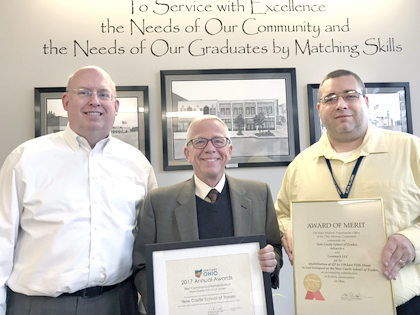 Morning Journal/Jo Ann Bobby-Gilbert The New Castle School of Trades in East Liverpool has been awarded for its attention to historic detail in renovating two formerly vacant buildings, and Director Jim Buttermore (center) shared the awards this week with (left) local architect Scott Shepherd and Mayor Ryan Stovall.