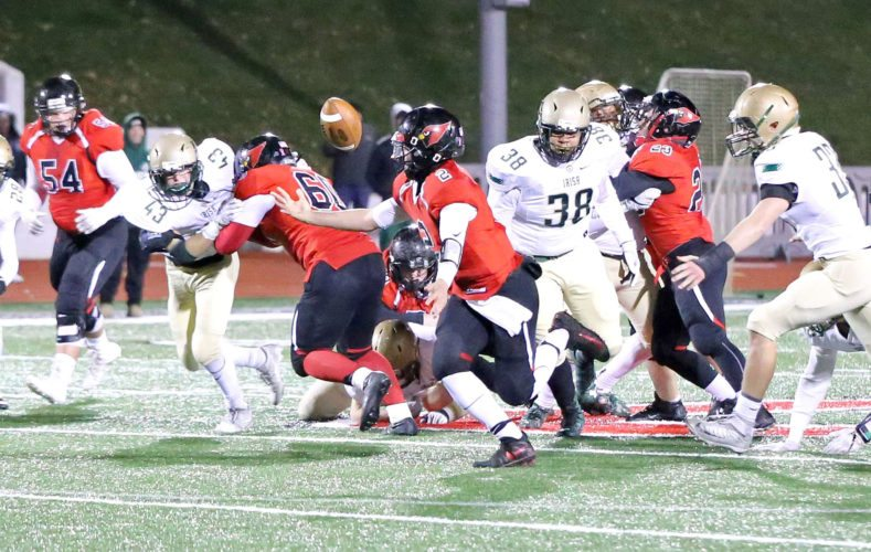 Canfield quarterback Vinny Fiorenza grabs a loose ball as Akron St. Vincent-St. Mary deenders Jack Knox (43)and David Hooks (38) close in during Fridy's Division IIIregional final at Reilly Stadium. (Special to the Journal/Gary Leininger)