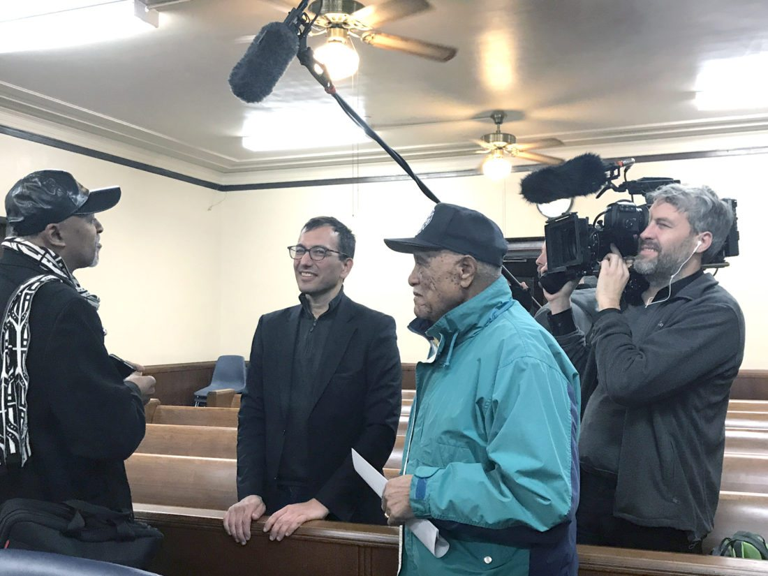 Morning Journal/Jo Ann Bobby-Gilbert East Liverpool Councilman Ernest Peachey (left) and Save Our County environmentalist Alonzo Spencer (right) speak with The New York Times reporter Eric Lipton as a news crew records their conversation.