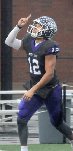 Mount Union sophomore quarterback D'Angelo Fulford celebrates after scoring a touchdown in Saturday's 21-0 NCAA Division III playoff win over Washington and Lee. Fulford has been named the Ohio Athletic Conference's top offensive back. (Morning Journal/Ron FIrth)