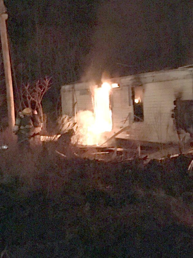Morning Journal/Katie White A stockpile of ammunition inside three mobile homes off Hazel Run Road in Washington Township posed some danger to firefighters battling a blaze Friday night, although no injuries were reported.