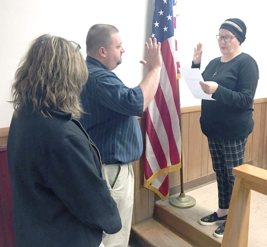 Morning Journal/Steve Rappach Frank Thorne is sworn in by Wellsville Mayor Nancy Murray as the village's newest full-time firefighter.  Behind Thorne is his girlfriend, Jean Pastore.