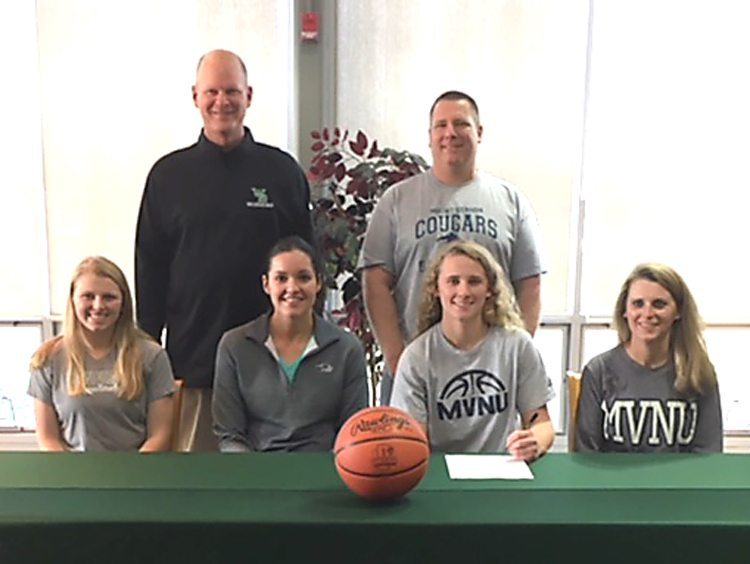 Hovorka signs with Mount Vernon Nazarene West Branch High School senior Kayla Hovorka will continue her academic and basketball careers at Mount Vernon Nazarene University next fall. Seated are (from left) sister Morgan Hovorka, Mount Vernon coach Amanda Short, Kayla Hovorka, mother Barb Hovorka. Standing are West Branch coach Walt DeShields and father Rob Hovorka.