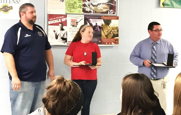 Submitted photo Winona Fire Chief George Brantingham, left, presents Medals of Valor to United High School 10th-grade student Shelby Kornbau and Assistant High School Principal Frank Baker for their actions in saving Shelby's father's life on Nov. 12 during a surprise recognition ceremony last week.