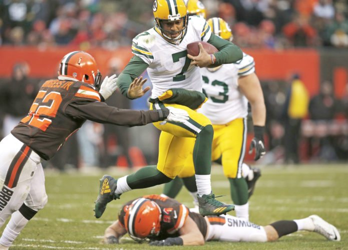 Green Bay Packers quarterback Brett Hundley (7) avoids Cleveland Browns inside linebacker James Burgess (52) in the second half of an NFL football game, Sunday, Dec. 10, 2017, in Cleveland. (AP Photo/Ron Schwane)