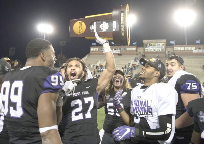 Mount Union cornerback Gabe Brown celebrates with the Purple Raiders after defeating Mary Hardin-Baylor in the Amos Alonzo Stagg Bowl in Salem, Virginia, on Friday night. (AP photo)