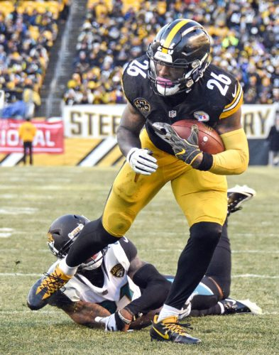Pittsburgh Steelers running back Le'Veon Bell heads for the end zone after slipping away from Jacksonville Jaguars' A.J. Bouye on Sunday. (AP Photo/Don Wright)
