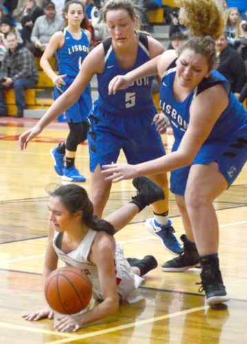 Columbiana's Kayla Muslovski tries to hold the ball under pressure from Lisbon's Maddie Liberati (right), Chloe Smith (5) and Izzy Perez.