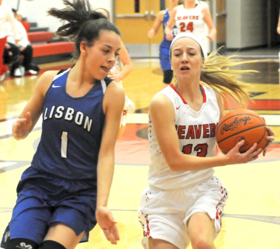 Beaver Local's Madison Ours goes to the basket on Lisbon's Izzy Perez       during Monday's game.