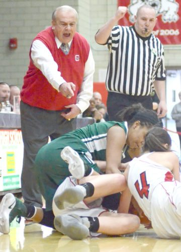 Morning Journal file/Patti Schaeffer Columbiana coach Ron Moschella reacts to a loose ball scramble during a 2017 district tournament game in Struthers against Ursuline.