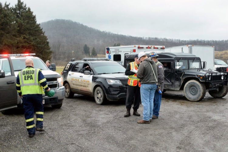 Special to the Journal/Scott McCloskey Emergency officials set up a command post along Ohio 148 next to the Clair Mar Golf Course in Powhatan Thursday while responding to an gas leak at XTO Energy's Schnegg well pad.