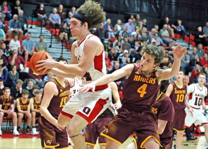 Salem's Chase Aukerman pulls down a rebound away from South Range's Brennan Toy on Tuesday.
