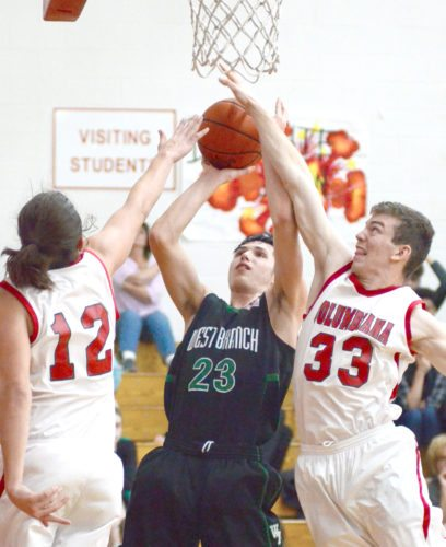 West Branch's Brandon Zuchowski shoots between Columbiana defenders Erik Hopfenziz (left) and Nate Whitehead on Tuesday.