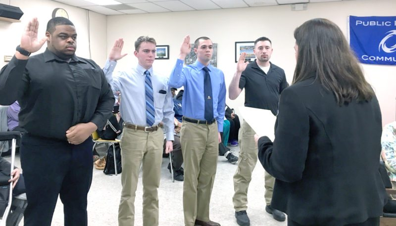 Morning Journal/Katie White Columbiana Municipal Attorney Amanda Banner administered the oath of office to four new members of the Columbiana auxiliary police force on Tuesday: (from left) Stephen Taylor Jr., Bradley McGovern, Ryan Marshburn and William Hewitt.