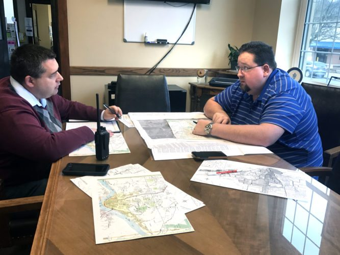 Morning Journal/Jo Ann Bobby-Gilbert Mayor Ryan Stovall (left) and Service-Safety Director Brian Allen spent much of Thursday mapping out which streets will be closed in the event of flooding overnight Sunday into Monday, which is a potential with predicted rainfall.