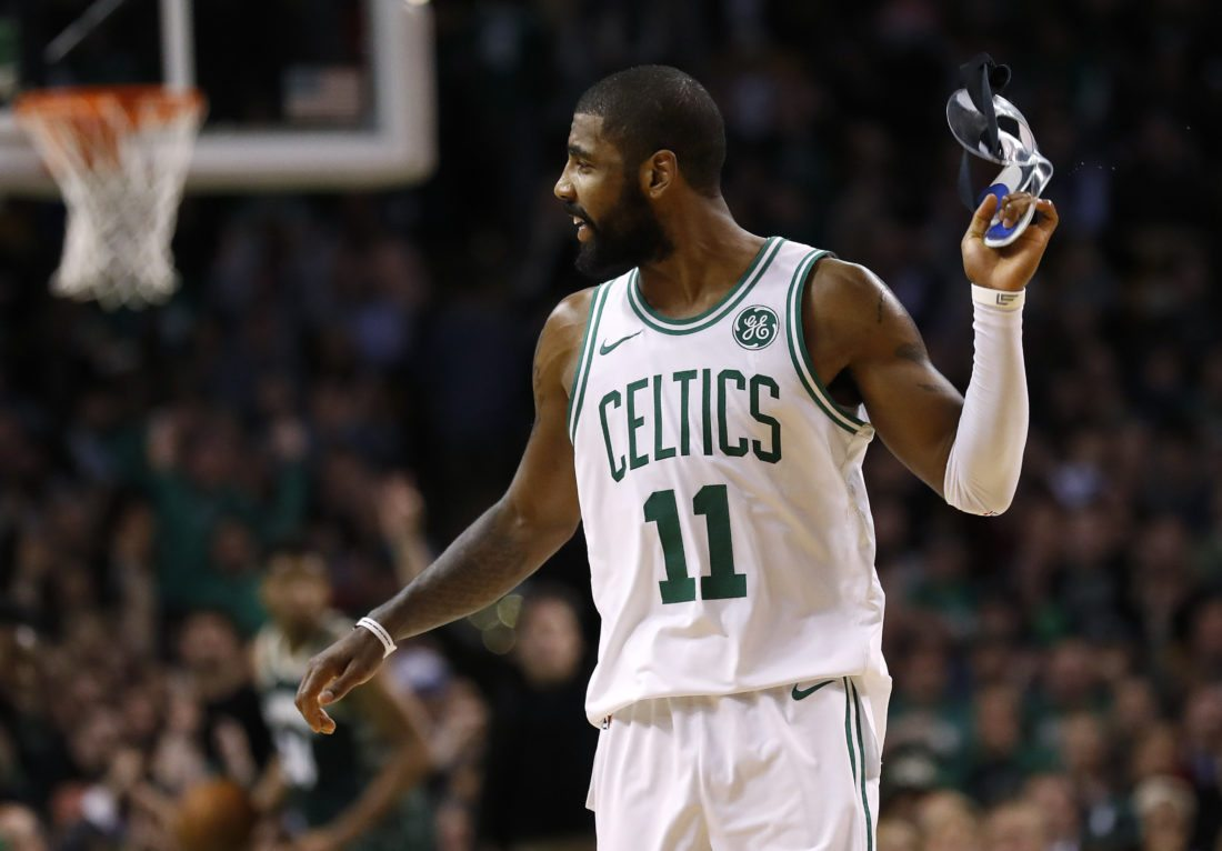 Irving, Horford lift Celtics past Bucks